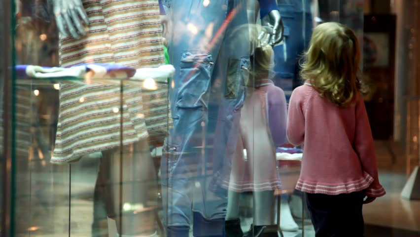 Little girl walking along the museum display window with exhibits in display  | Shutterstock HD Video #783469