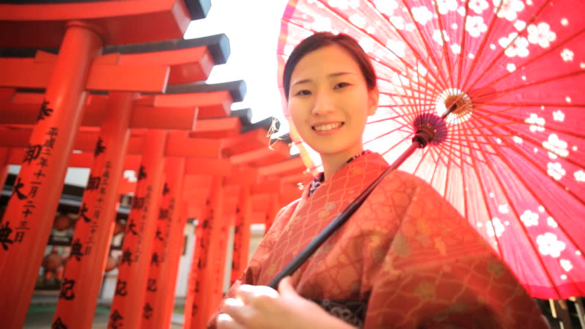 Travel tourism Japan happy young Asian Japanese female traditional red kimono parasol portrait promotional welcome outdoors location | Shutterstock HD Video #7836205
