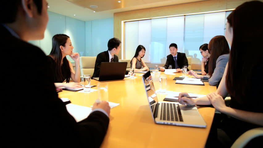 Ethnic Asian Chinese smart businessmen businesswomen corporate management conference meeting wireless laptop device planning | Shutterstock HD Video #7852240