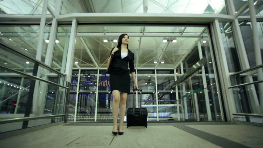 Smart Asian Chinese female financial consultant city airport travel meeting conference baggage departure destination corporate business #7854667