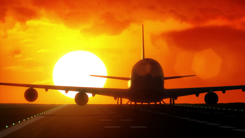 Jet plane departs from airport runway as silhouette in front of large sunset / sunrise 4K UltraHD #7859380