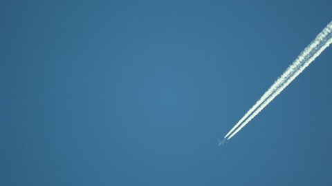 Airplane contrails in the sky