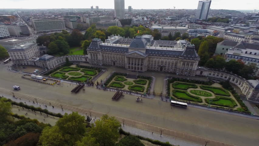 Royal Palace of Brussels marching cavalry aerial city view fly