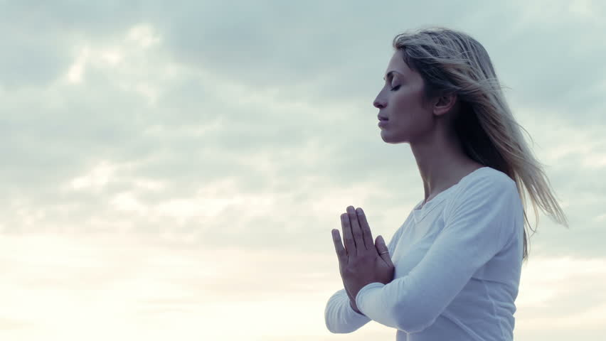 Young woman in meditation near the sea: practicing yoga   Shutterstock HD Video #7900825