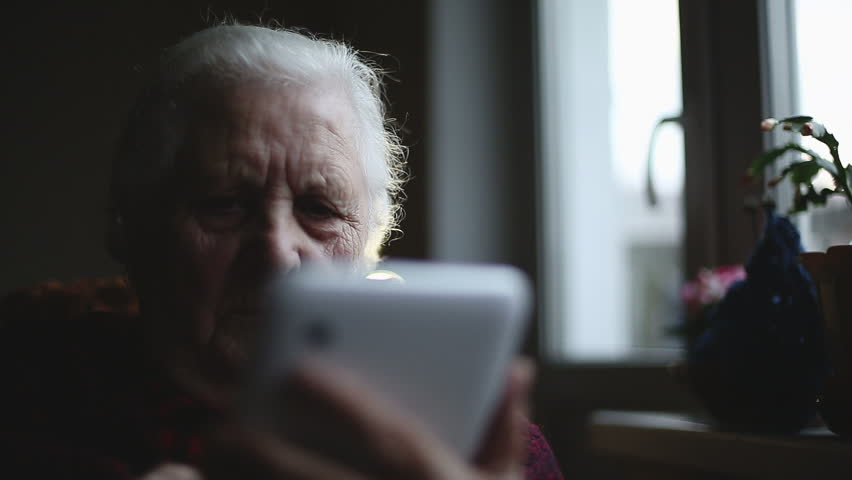 Old woman and electronic tablet. Close up | Shutterstock HD Video #7902556