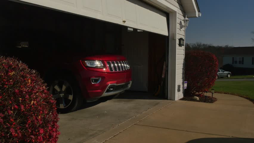 A garage door opens automatically.