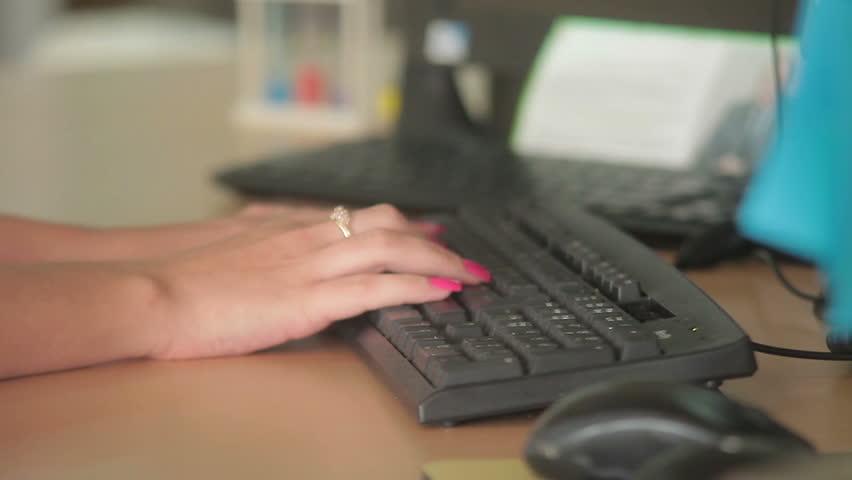 Female hands working on keyboard | Shutterstock HD Video #7958788