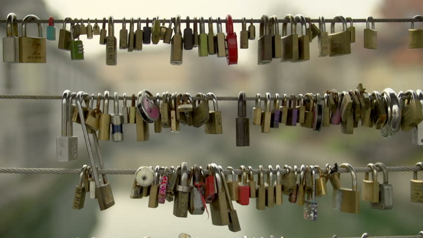 Locks in a bridge's fence | Shutterstock HD Video #7964953