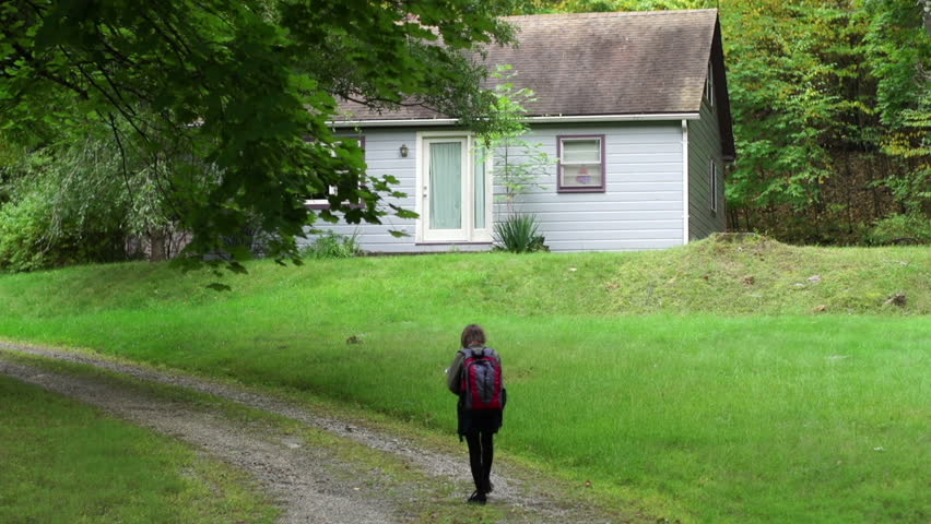 A tween girl walks home alone from school to a secluded cottage in the woods - property released   Shutterstock HD Video #7972567