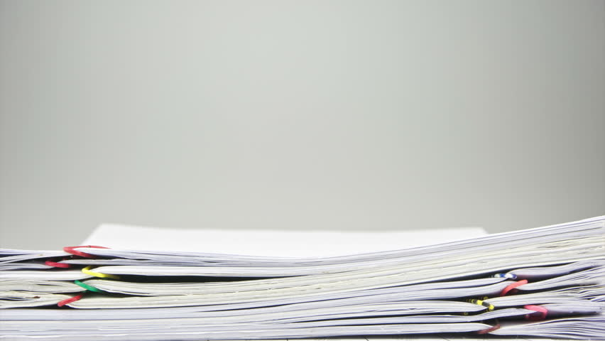 Stack paperwork of sales and receipt overload place on table with white background time lapse. Pile of organized document is increasing up with colorful paperclip. Business concept footage. | Shutterstock HD Video #7998034