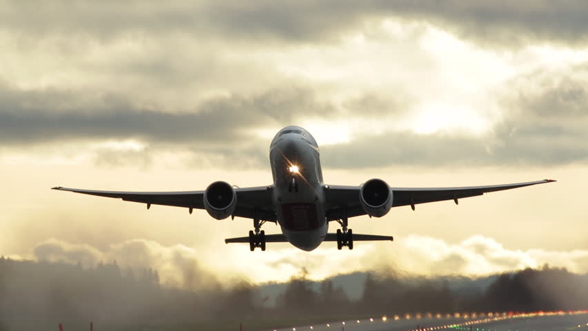 EMIRATES BOEING 777 AIRPLANE AT OSLO AIRPORT NORWAY- CA OCTOBER 2014: Great view of the take off in backlight conditions. Very powerful engines