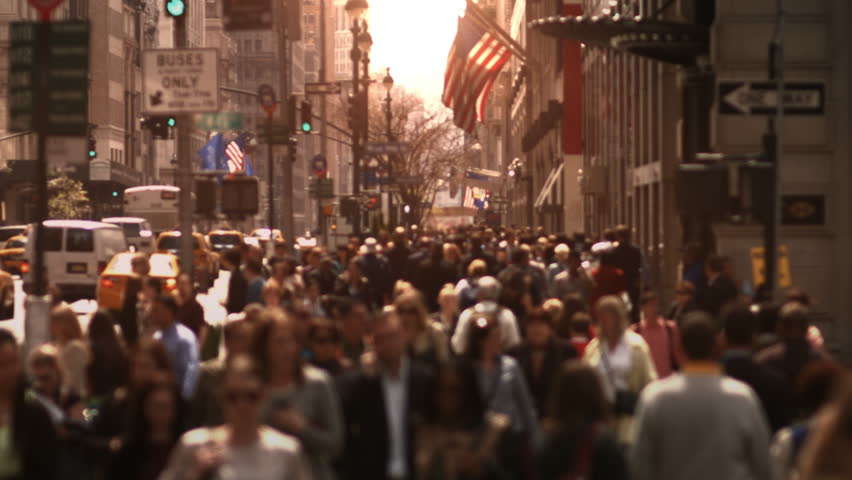 Large crowd of people walking in a big city street. Anonymous crowd. Daytime. High angle. More options in my portfolio. MORE OPTIONS IN MY PORTFOLIO.   Shutterstock HD Video #8038405