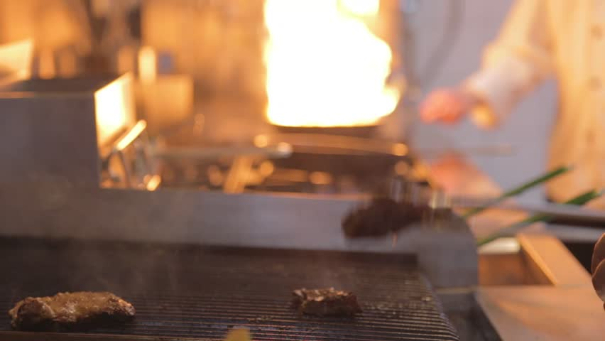 TAIPEI,TAIWAN - CIRCA October 2013 :cook barbeque steak | Shutterstock HD Video #8040268