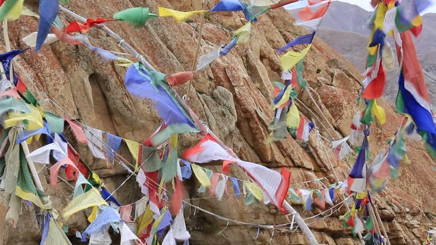 Plenty of colorful Buddhist prayer flags on the Stupa near Takthok gompa, Buddhist monastery in Ladakh, Jammu & Kashmir, India | Shutterstock HD Video #8055439