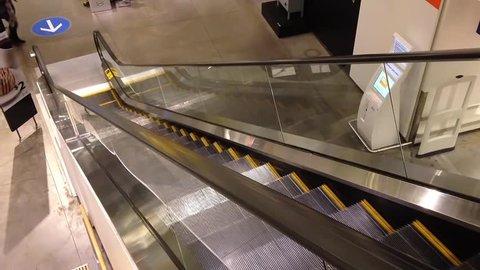 Coquitlam, BC, Canada - November 16, 2014 : People climb the escalator inside Ikea in Coquitlam BC Canada.