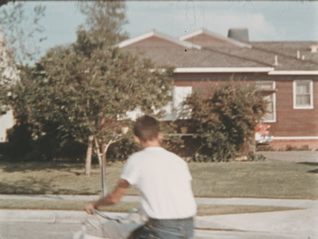 UNITED STATES CIRCA 1960 - Newspaper printing process. Paper boy delivers papers to houses and establishments in a roundabout until the newspaper reaches the hands of the barbershop clients.