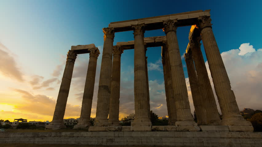 4K Motion controlled sunset Timelapse of pillars In the temple of Olympian Zeus in Olympeion of Athens Greece. Beautiful blue sky and clouds passing over. Acropolis to the left.