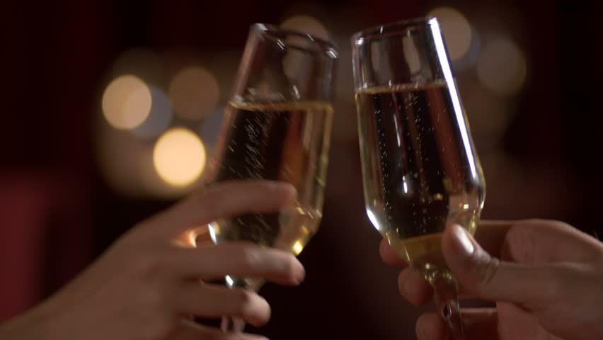 Couple Dinning and toasting -Detail shot. Indoors, restaurant, romantic dinner. 4k | Shutterstock HD Video #8095153