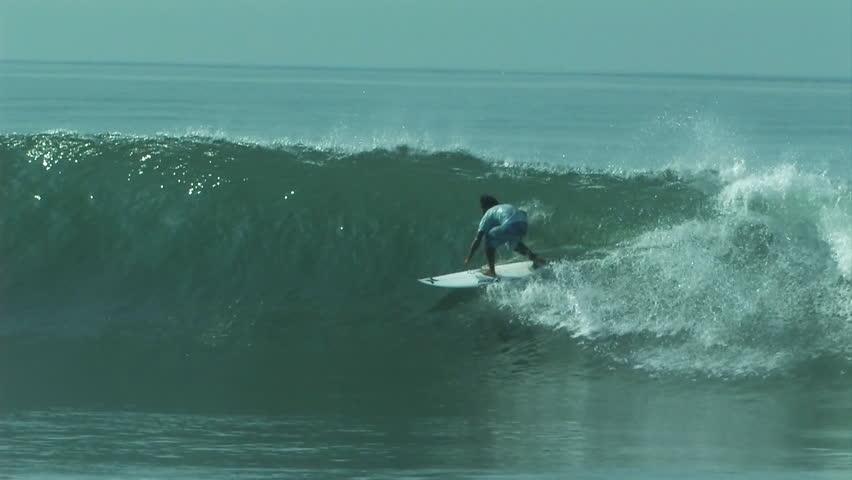 A surfer gets barreled on a nice little wave   Shutterstock HD Video #8099860