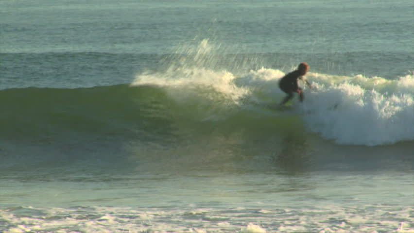 A surfer rides up and down a nice little wave   Shutterstock HD Video #8100853