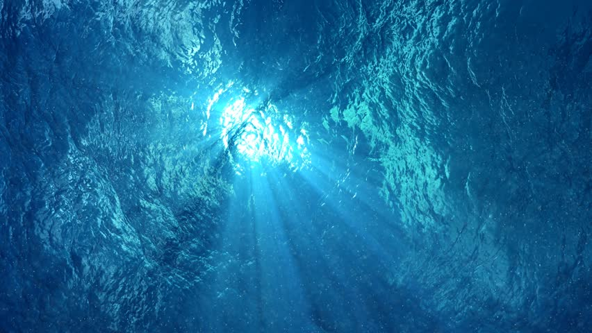 4K - quality Looping animation of ocean waves from underwater, diving in tropics. Light rays shining through. Great popular marine Background. (seamless loop, 4k,ultra high definition, 3840 X 2160)