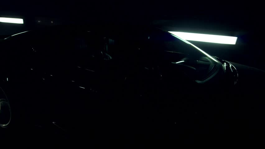 Aston Martin in a light tunnel in London. Moving at night | Shutterstock HD Video #8119789