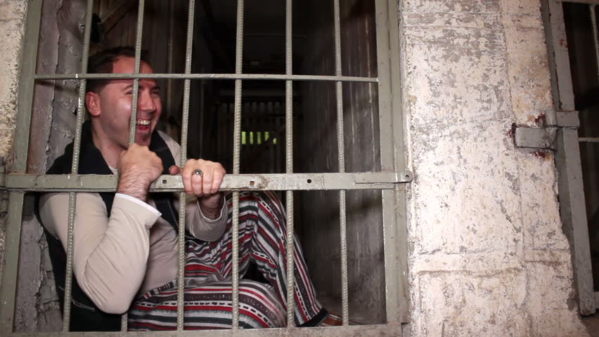 Mad Prisoner Laughing Through the Stock Footage Video (100% Royalty-free) 8130127 | Shutterstock