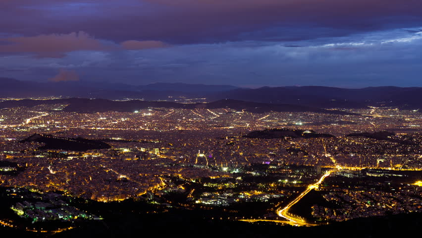 4K Wide view dusk to night timelapse of Athens skyline on a very clear winter day.City lits up as dusk turns into night.Sequence has been de-flickered making the transition from day to night seamless.