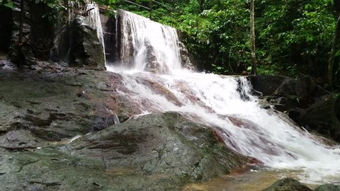 Fresh waterfall in tropical rainforest with 4K resolution