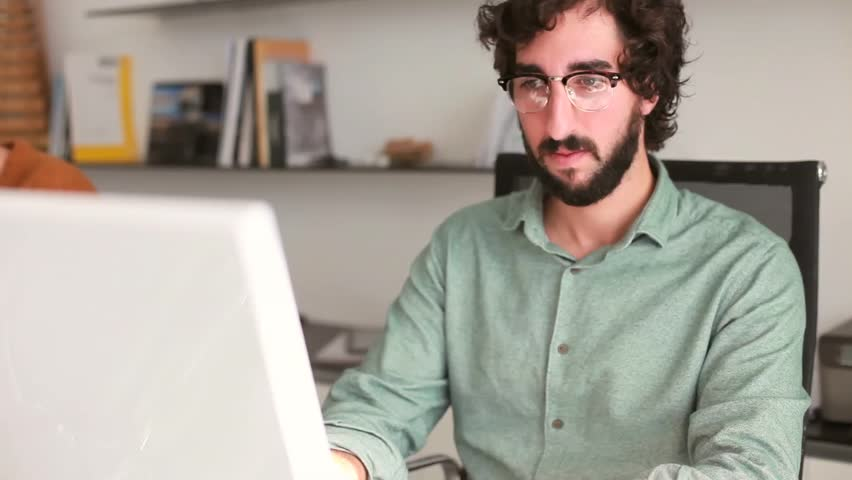 Cool young man working on his computer | Shutterstock HD Video #8158798