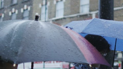 Umbrellas come out as rain fall in London City, United Kingdom, European weather front moves in.