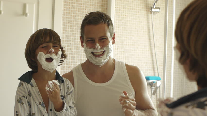Father And Son With Shaving Cream On Their Faces. #8188159