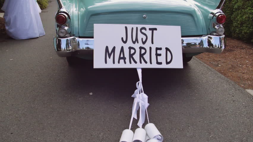 Old time Car with Just Married Sign Cans in Slow Motion