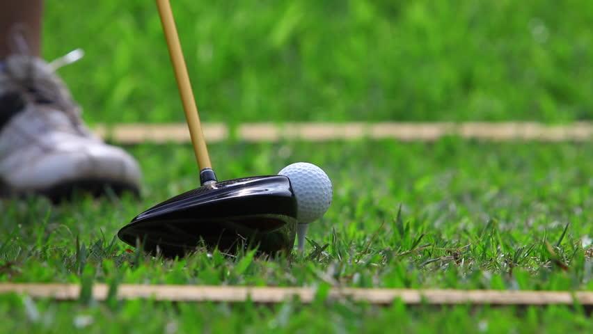 Golf strike - Golfer hitting a ball - Close up  | Shutterstock HD Video #8197360