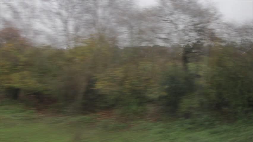 POV through Window Train Travels Past Suburban Scene Residential Houses. No People - Urban Transport Backgrounds  28th November 2014  Location: Birmingham, UK  Source: Canon 5DMkiii | Shutterstock HD Video #8216533