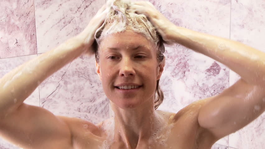 Young Woman Washing Hair While Taking Shower Stock Image