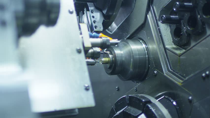 CNC Lathe Machine Produces Metal Detail on Factory.  Shot on RED Cinema Camera in 4K. Its easy scale, rotate and crop without loosing quality.