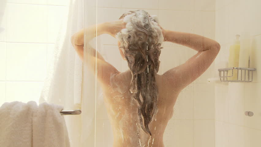 Beautiful Naked Young Woman Smiling While Taking Shower In Bathroom Stock Photo
