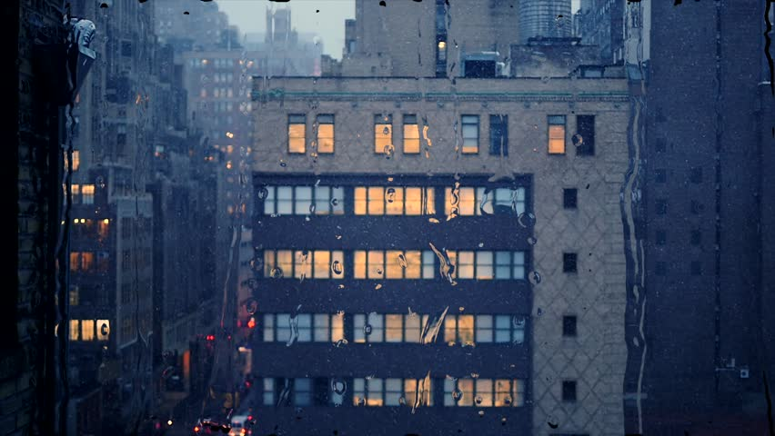 Winter scene of snow falling in city. cold snowing day in new york city