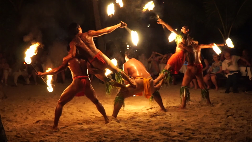 FRENCH POLYNESIA - JULY 7: Polynesian cultural music and fire dance performance on Bora Bora Island, French Polynesia.