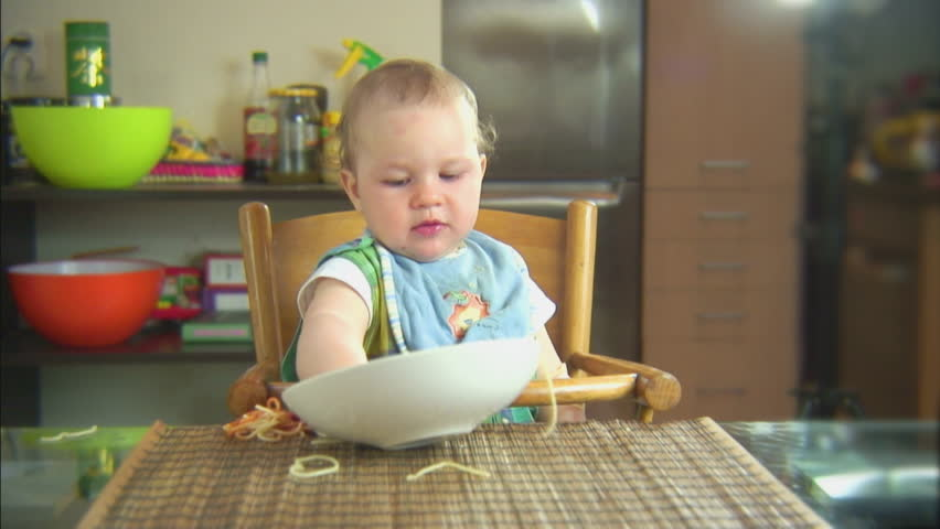 Funny child playing with spaghetti and sauce. Scene 5 #8257546