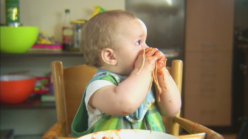 Funny child playing with spaghetti and sauce. Scene 6 #8257570