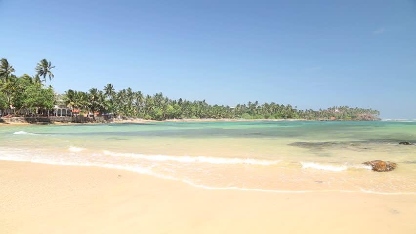 Paradise tropical sandy beach in Mirissa, Sri Lanka.   Shutterstock HD Video #8278030