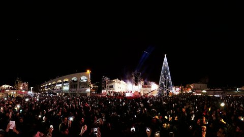NAZARETH, ISRAEL - DECEMBER 17, 2014: Fireworks during the lighting of the Christmas tree in Nazareth, video panorama
