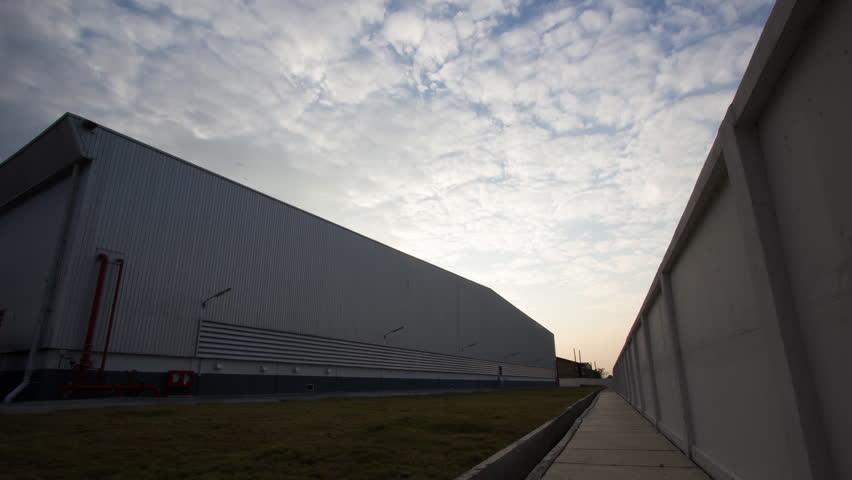 Evening skyline of warehouse. Timelapse.   Shutterstock HD Video #8294191