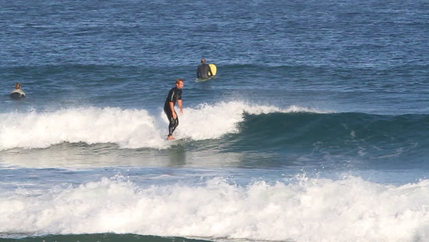 A surfer uses pump technique to gain some speed, performs a jump before spinning in mid air and falling into water   Shutterstock HD Video #8302681