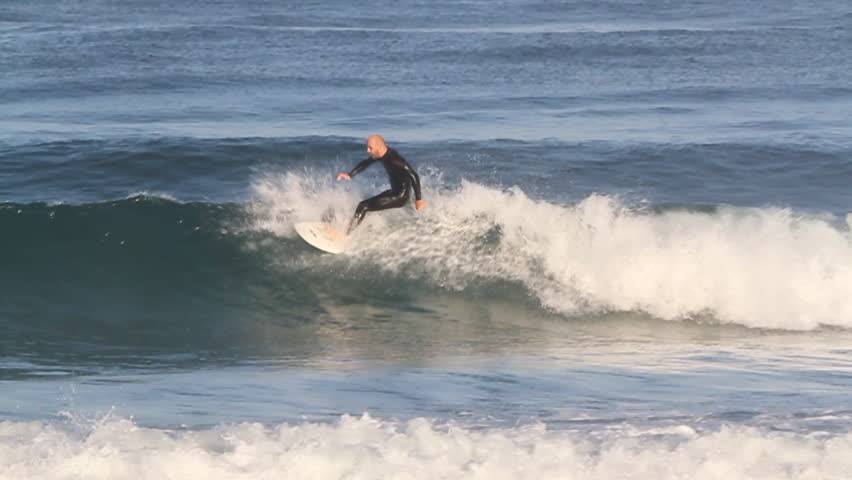 A surfer falls into water while riding a wave   Shutterstock HD Video #8302684