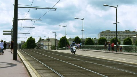 ROUEN FRANCE - JULY 2013: A tram passes on Port Jeanne d'Arc in the historic city of Rouen France.