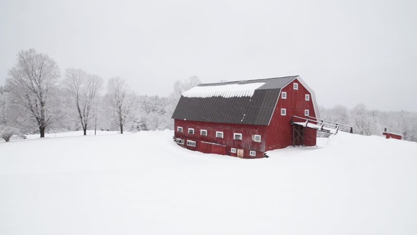 ETNA, NEW HAMPSHIRE December 16th: Snow falling on a classic New England farm and red barn in Etna, New Hampshire on December 16th, 2014 in Etna, New Hampshire.