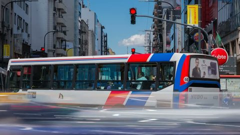 BUENOS AIRES, ARGENTINA - DECEMBER 22: Timelapse of rush hour traffic on Avenida Corrientes in the centre of Buenos Aires, Argentina on a hot summer day on December 22, 2014.